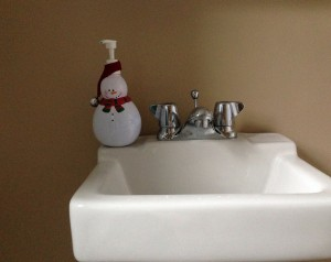 snowman soap dispenser adds Christmas cheer to a bathroom