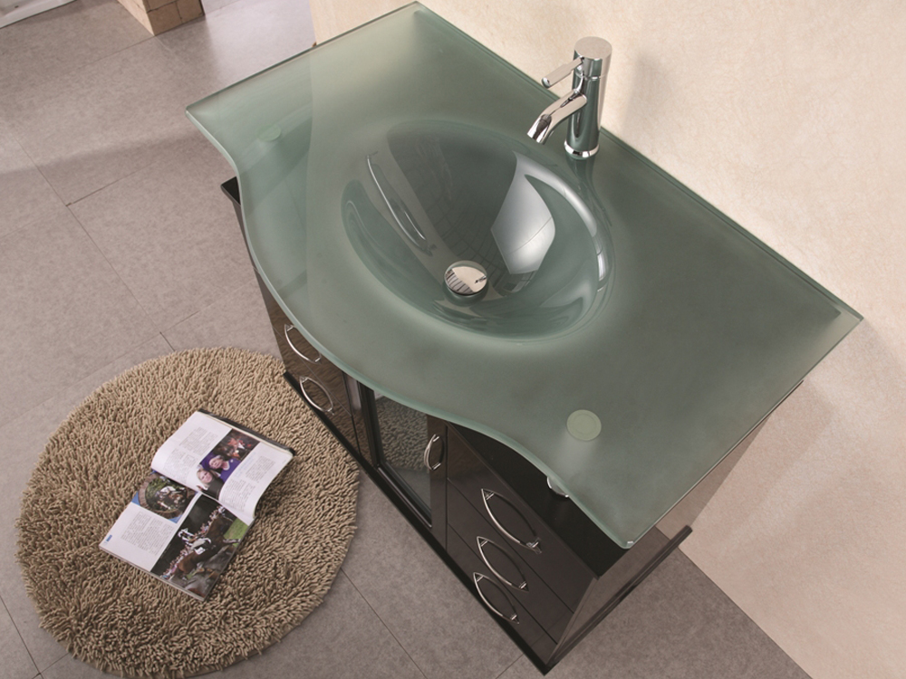 Integrated glass sink and top